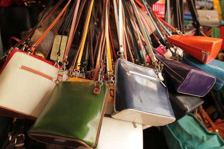 Colourful handbags for sale on market in Covent Garden in London Foto de archivo
