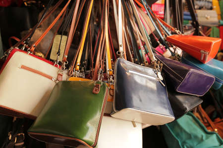 Colourful handbags for sale on market in Covent Garden in London Imagens