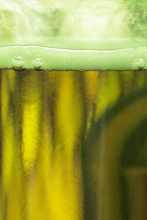 Texture of a green beer bottle photo