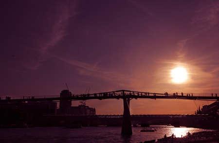 London Millennium Footbridge across Thames river at sunset photo