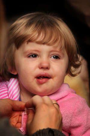 Cute little  baby girl being unhappy and about to start crying Stock Photo - 22885720