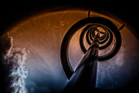 Abstract industrial background of toned detail of a metallic spiral photo