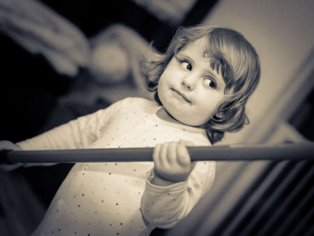 mischevious: Portrait of a happy cute little baby playing at home