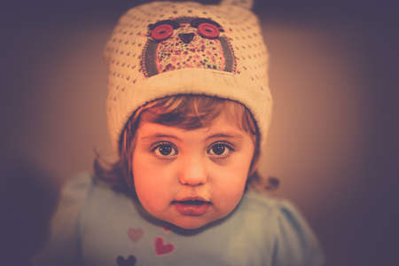 Portrait of a cute little baby girl with a hat photo