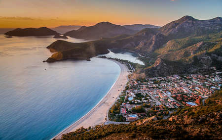 Sunset over the sea in Oludeniz, Turkey photo