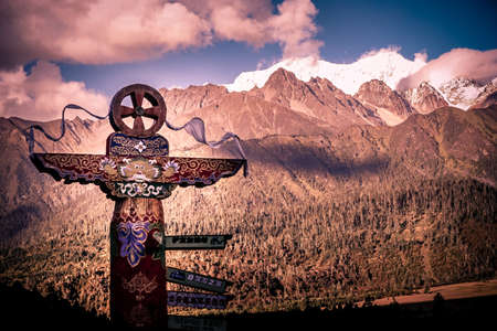 Wooden totem and stunning mountains  photo