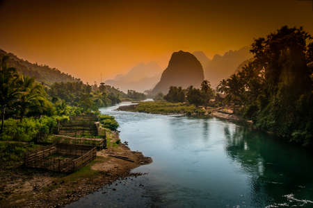 Beautiful karst hills landscape along Nam Song river near Vang Vieng in Laos Stock Photo