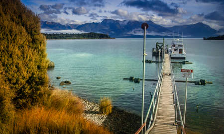 Wooden pier on Te Anau lake in New Zealand South Island photo