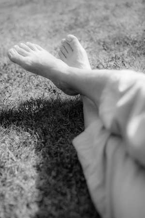 Men s feet on the grass in the park in summer photo