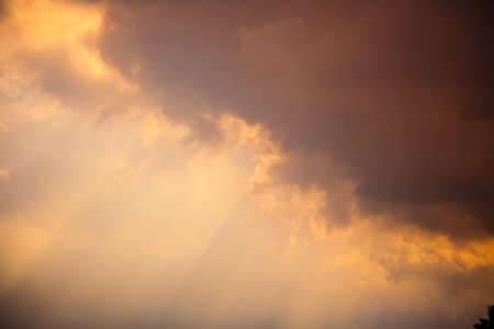 cloud drift: Horizontal picture of sunbeams and clouds in the sky Stock Photo