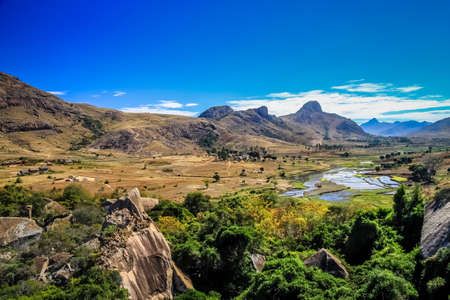 Ricefields as a part of stunning rural landscape of Madagascar central highlands Imagens