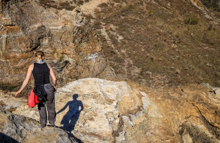 Single woman trekking through large rock in Isalo National Park in Madagascar photo