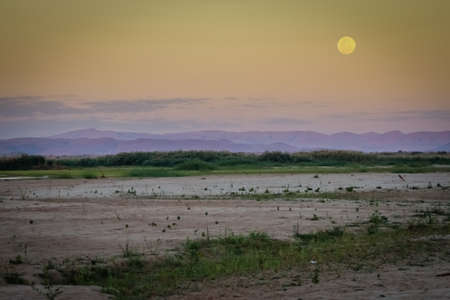 Full moon shining over Tsiribihina river in Madagascar photo