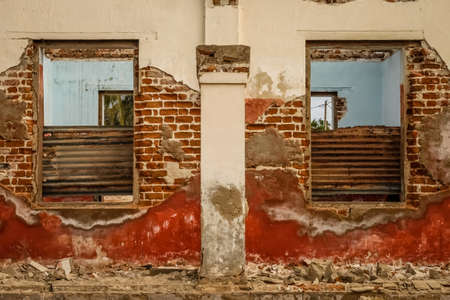 eyesore: Windows of the old ruined colonial home in Madagascar Stock Photo
