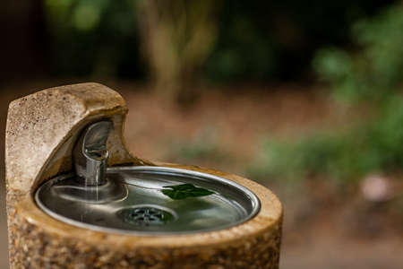 Fresh water drinking fountain in a park photo