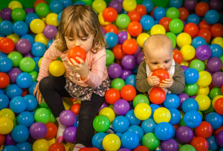 Kids having fun in an indoor playground in an activity centre photo