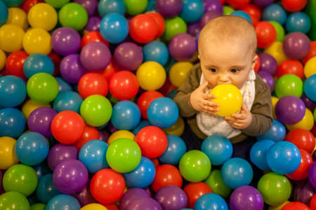 Little boy having fun in an indoor playground in an activity centre photo
