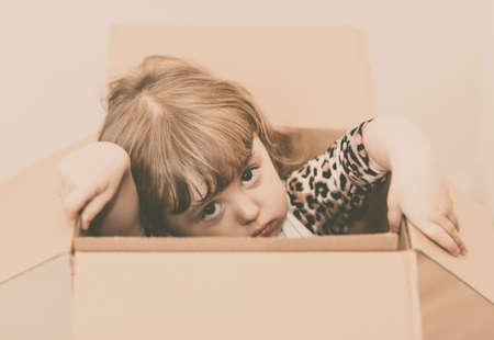 popping out: Girl popping out of a cardboard box
