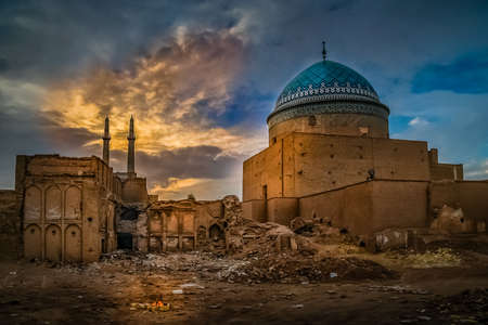 partly: Old partly ruined mosque in Yazd in Iran Stock Photo