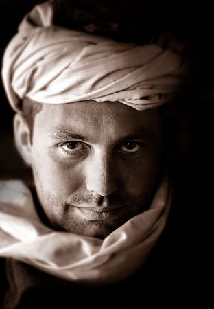 taliban: Portrait of a caucasian man wearing a beduin scarf Stock Photo
