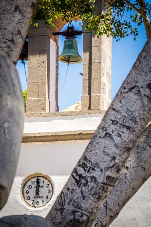 pueblo: Bell and clock on a church in Fataga town in Gran Canaria Canary Islands Spain Stock Photo