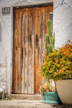 season specific: Wooden doors to one of the homes in Fataga in Gran Canaria Canary Islands