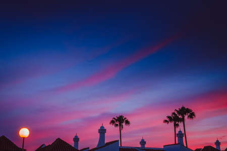 contrasted: Dramatic sunset over residence in Maspalomas in Gran Canaria