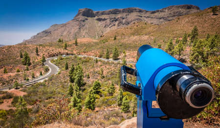Viewing telescope on the scenic lookout in the mountains in Gran Canaria Spain photo