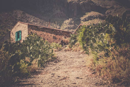 Gravel road leading to a small village home  looking abandoned  in Gran Canaria Spain photo
