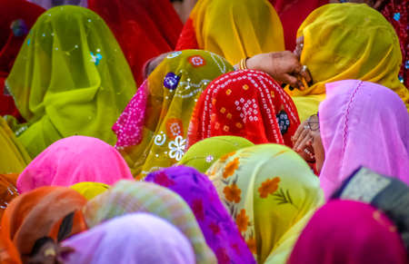 jaipur: Colourful crowd of Indian women sitting together in Jaipur, India