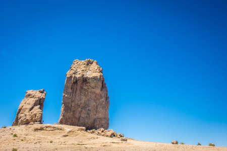 tableau: Gigantic Roque Nublo monolith in Gran Canaria Spain