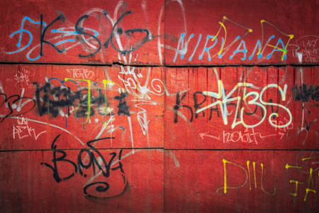 vandalize: Graffiti on the steel red rusted wall Poland