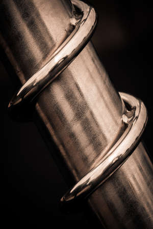 twisting: Close up of a twisting metal spiral over black background