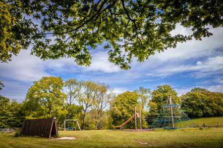 Large empty outdoor activity playground for children Stock Photo