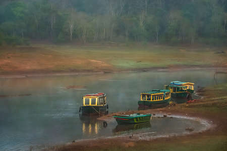 periyar: Moored boat on the lake shore in the Periyar National Park India Stock Photo