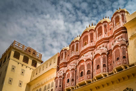 polygamy: Balconies of the Hawa Mahal, The Palace of Winds, Jaipur, Rajasthan, India Editorial