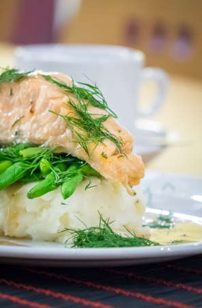 main course: Roast salmon main course served with mashed potatoes and green beans