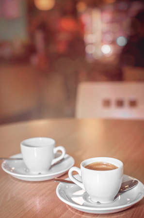 hot coffees: Two espresso coffees on a table in a restaurant