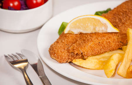 side salad: Gourmet fish and chips meal served with side salad Stock Photo