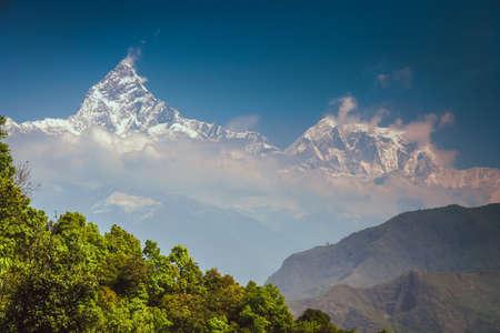 dominating: Mount Machhapuchhre dominating above city of Pokhara, Nepal Stock Photo