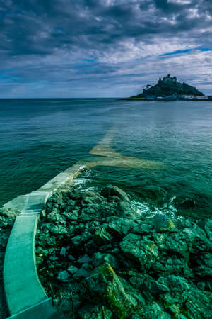 submerged: Causeway to the St Michaels Mount in Marazion submerged by high tide at evening, Cornwall, England