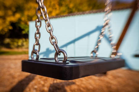 lonliness: Picture of an swing in an outdoor playground Stock Photo