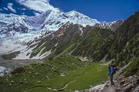 vast: Trekker walking on a trail leading to the base camp of Rakaposhi in Karakorum in Pakistan