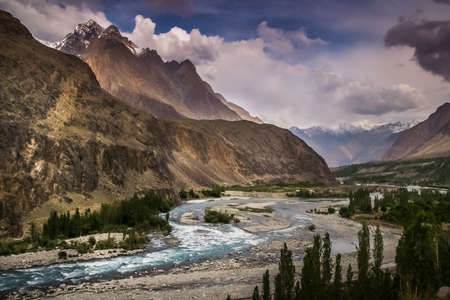 tributary: Picture of Gilgit river, tributary of the Indus river, flowing through the beautiful mountain valley in the Karakorum Stock Photo