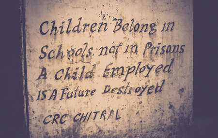 belong: Children belong in schools not in prisons, a child employed is a future destroyed - quote on the municipal building in Chitral, Pakistan