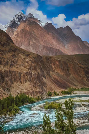 tributary: Picture of Gilgit river, tributary of the Indus river, flowing through the beautiful mountain valley in the Karakorum mountains in Pakistan