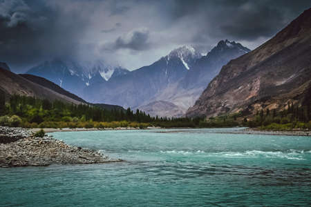 tributary: Gilgit river, tributary of the Indus river, flowing through the beautiful mountain valley in the Karakorum mountains in Pakistan