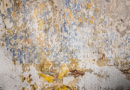 exfoliate: Rough abstract wall texture on a wall of an old building