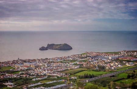 retreat: View of the small Ilheu da vila island which a popular summer retreat for people in Vila Franca do Campo in Sao Miguel Island in the Azores. Stock Photo