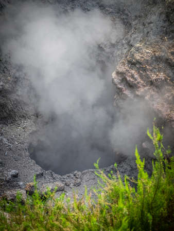 fissures: Geothermal hot water hole in Furnas, Sao Miguel, Azores, Portugal Stock Photo